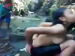 asian teen babe bathing at the river