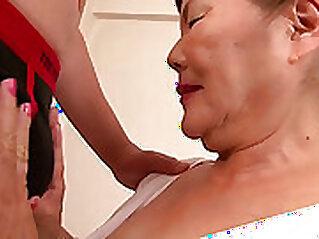 Busty grandma rubs her lovely body