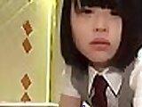 Cute Japanese schoolgirl masturbating on bed